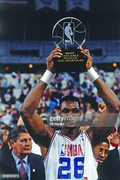 Karl Malone of the Western Conference AllStars hoists the MVP trophy following the 1989 NBA AllStar Game on February 12 1989 at the Astrodome in...