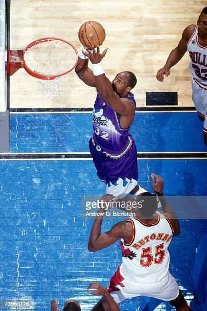 Karl Malone of the Western Conference shoots against Dikembe Mutombo of the Eastern Conference during the 1997 AllStar Game on February 9 1997 at...
