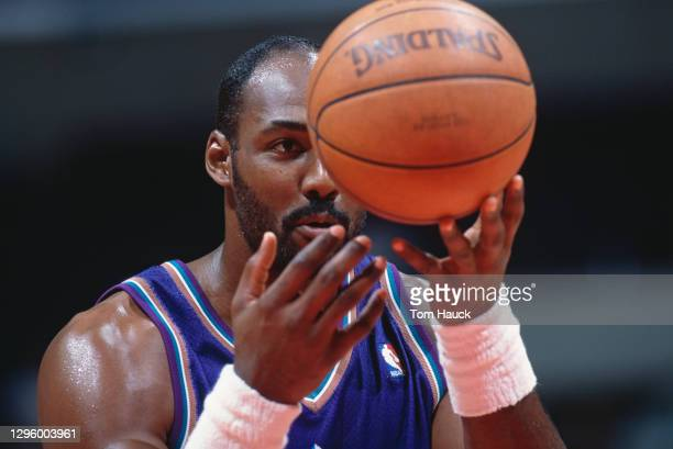Karl Malone, Power Forward for the Utah Jazz looks at the basketball as he prepares to make a free throw during the NBA Pacific Division basketball...