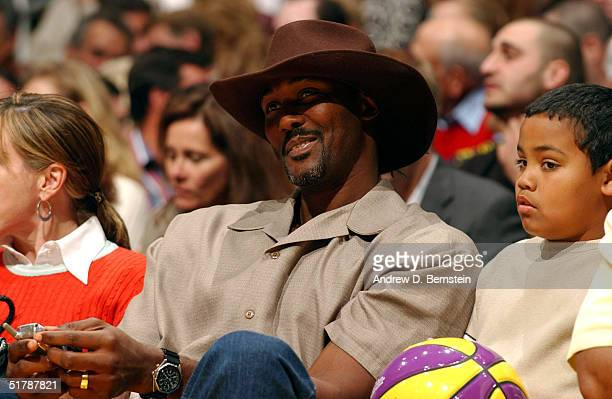 Karl Malone sits courtside at the Los Angeles Lakers vs Milwaukee Bucks game on November 23 2004 at the Staples Center in Los Angeles California NOTE...