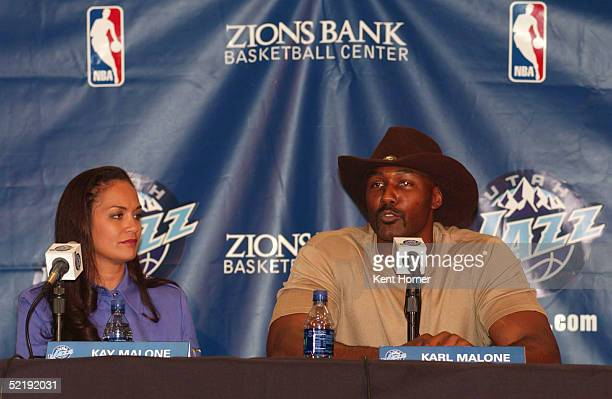 Karl Malone with wife Kay announces his retirement from the NBA on February 13 2005 at the Delta Center in Salt Lake City Utah NOTE TO USER User...