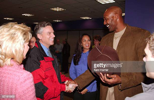 Karl Malone with wife Kay greet the Governor of Utah John Huntsman prior to announcing his retirement from the NBA on February 13 2005 at the Delta...