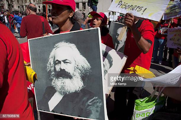 Karl Marx poster Demonstration by unions and other organisations of workers to mark the annual May Day or Labour Day Groups from all nationalities...
