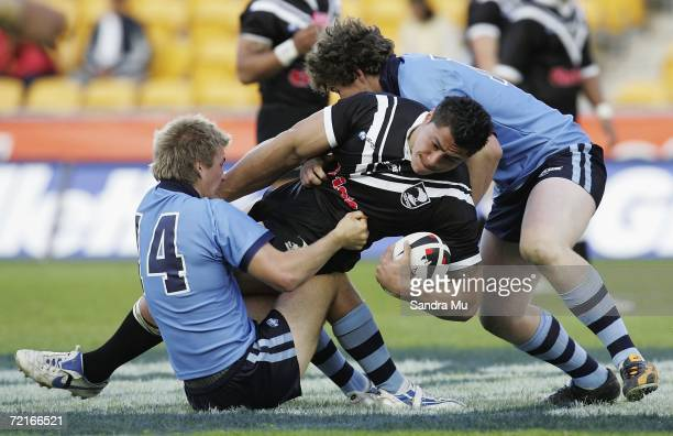 Karl McNichol of the Junior Kiwi's gets tackled during the match between the Junior Kiwis and the New South Wales U18s at Mt Smart Stadium on October...