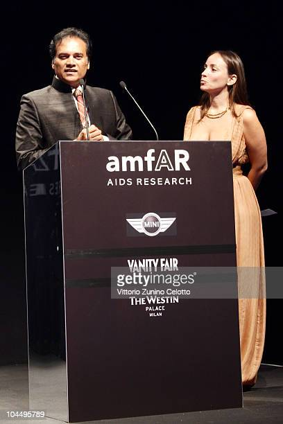 Karl Mootoosamy and Camila Raznovich attend amfAR Milano 2010 Auction during Milan Fashion Week Womenswear Spring/Summer 2011 at La Permanente on...