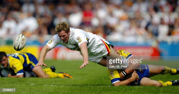 Karl Pratt of Bradford Bulls loses the ball as he is tackled during the Tetleys Super League match between Warrington Wolves and Bradford Bulls held...