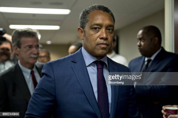 Karl Racine District of Columbia attorney general center and Brian Frosh Maryland attorney general left arrive at a news conference in Washington DC...