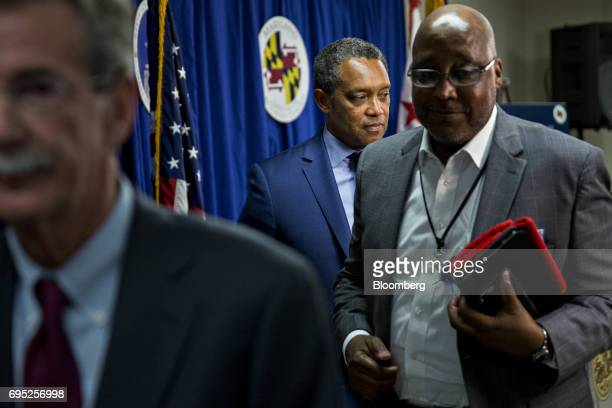 Karl Racine District of Columbia attorney general center walks out after a news conference in Washington DC US on Monday June 12 2017 President...