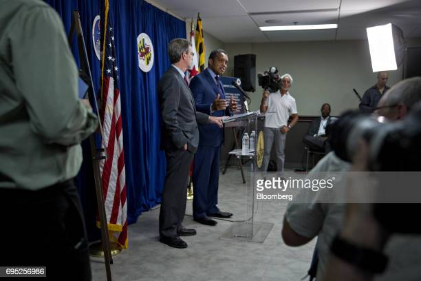 Karl Racine District of Columbia attorney general right speaks as Brian Frosh Maryland attorney general listens during a news conference in...