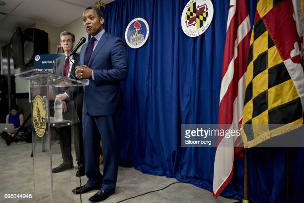 Karl Racine District of Columbia attorney general speaks as Brian Frosh Maryland attorney general left listens during a news conference in Washington...