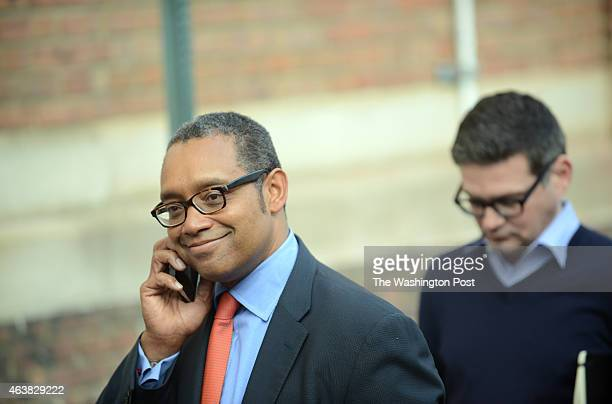 Karl Racine who is considered the front runner for the office of DC Attorney General makes a telephone call while waiting in line to vote at Garnet...
