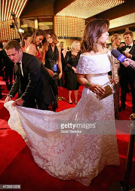 Karl Stefanovic adjusts the dress of Lisa Wilkinson at the 57th Annual Logie Awards at Crown Palladium on May 3 2015 in Melbourne Australia
