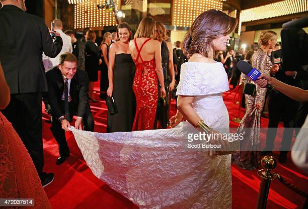 Karl Stefanovic bends down to adjust the dress of Lisa Wilkinson as she arrives at the 57th Annual Logie Awards at Crown Palladium on May 3 2015 in...