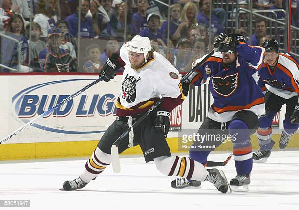Karl Stewart of the Chicago Wolves is hooked by Patrick Sharp of the Philadelphia Phantoms during the American Hockey League Calder Cup final game at...