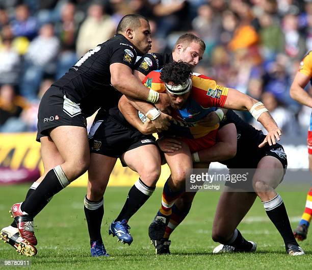 Karl Temata of Harlequins is tackled during the Engage Super League Magic Weekend game between Hull FC and Harlequins at Murrayfield on May 1 2010 in...