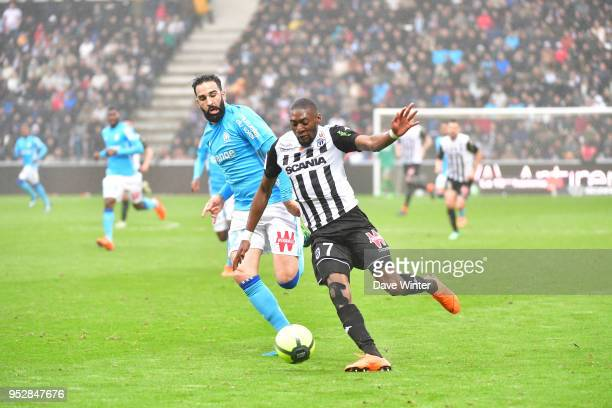 Karl Toko Ekambi of Angers and Adil Rami of Marseille during the Ligue 1 match between Angers SCO and Olympique Marseille at Stade Raymond Kopa on...