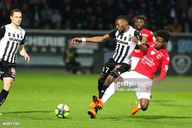 Karl Toko Ekambi of Angers and Adrien Tameze of Nice during the Ligue 1 match between Angers SCO and OGC Nice at Stade Raymond Kopa on April 13 2018...