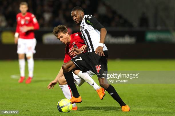 Karl Toko Ekambi of Angers and Arnaud Souquet of Nice during the Ligue 1 match between Angers SCO and OGC Nice at Stade Raymond Kopa on April 13 2018...