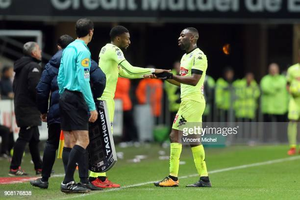 Karl Toko Ekambi of Angers and Gilles Sunu of Angers during the Ligue 1 match between Rennes and Angers at Roazhon Park on January 20 2018 in Rennes...
