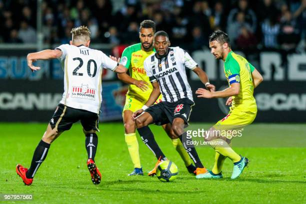 Karl Toko Ekambi of Angers and Leo Dubois of Nantes during the Ligue 1 match between Angers SCO and Nantes at Stade Raymond Kopa on May 12 2018 in...