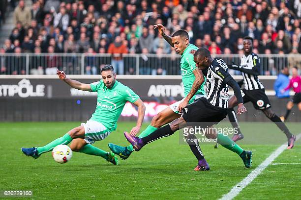 Karl toko Ekambi of Angers and Leo Lacroix and Loic Perrin of SaintEtienne during the French Ligue 1 match between Angers and Saint Etienne on...