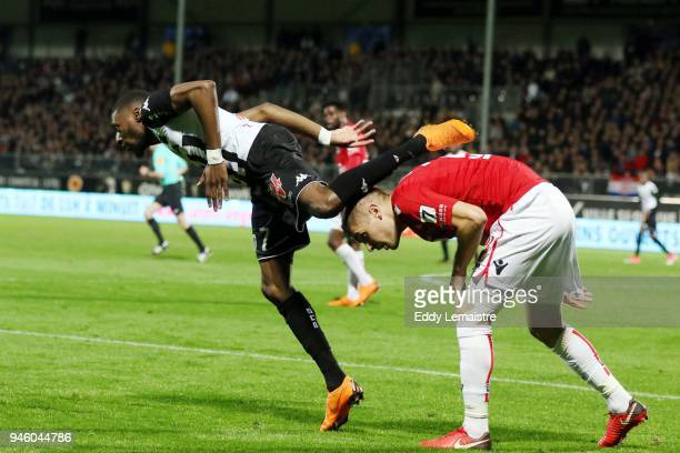 Karl Toko Ekambi of Angers and Maxime Le Marchand of Nice during the Ligue 1 match between Angers SCO and OGC Nice at Stade Raymond Kopa on April 13...