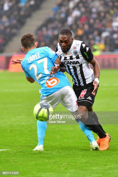 Karl Toko Ekambi of Angers and Maxime Lopez of Marseille during the Ligue 1 match between Angers SCO and Olympique Marseille at Stade Raymond Kopa on...