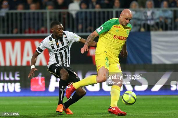 Karl Toko Ekambi of Angers and Nicolas Pallois of Nantes during the Ligue 1 match between Angers and Nantes at Stade Raymond Kopa on May 12 2018 in...