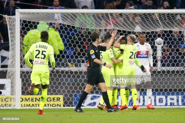 Karl Toko Ekambi of Angers and Pierrick Capelle of Angers and Flavien Tait of Angers during the Ligue 1 match between Lyon and Angers at Groupama...