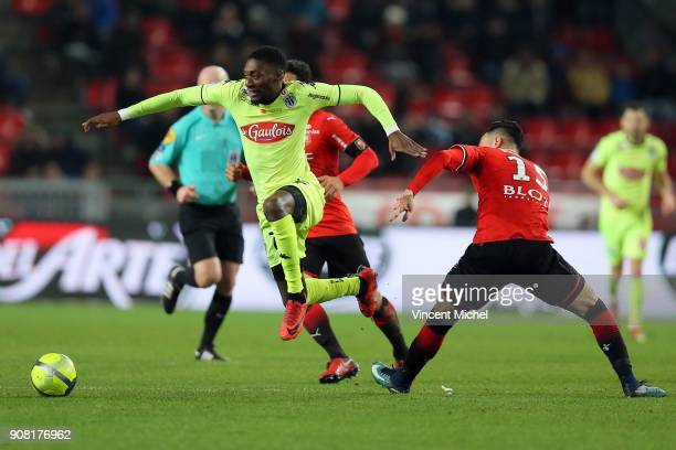 Karl Toko Ekambi of Angers and Rami Bensebaini of Rennes during the Ligue 1 match between Rennes and Angers at Roazhon Park on January 20 2018 in...