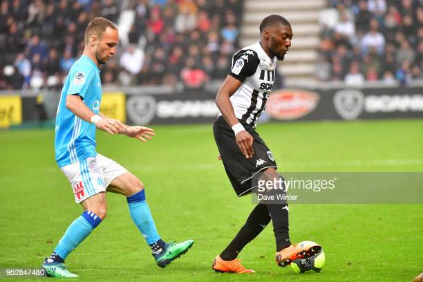 Karl Toko Ekambi of Angers and Valere Germain of Marseille during the Ligue 1 match between Angers SCO and Olympique Marseille at Stade Raymond Kopa...