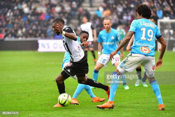 Karl Toko Ekambi of Angers beats Bouna Sarr of Marseille during the Ligue 1 match between Angers SCO and Olympique Marseille at Stade Raymond Kopa on...