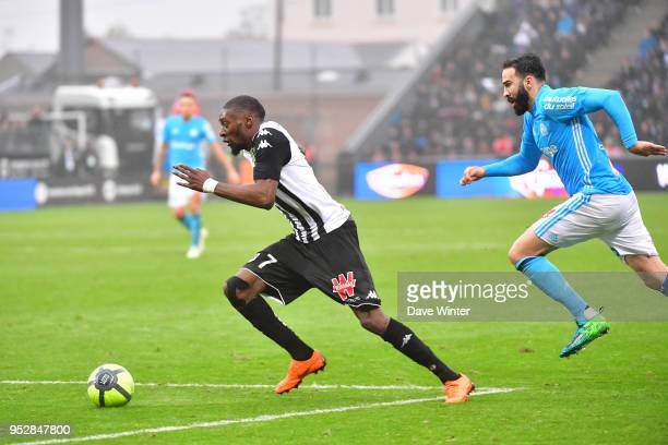 Karl Toko Ekambi of Angers pursued by Adil Rami of Marseille during the Ligue 1 match between Angers SCO and Olympique Marseille at Stade Raymond...