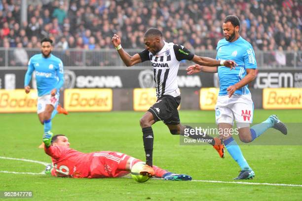 Karl Toko Ekambi of Angers tries to beat goalkeeper Yohann Pele of Marseille during the Ligue 1 match between Angers SCO and Olympique Marseille at...