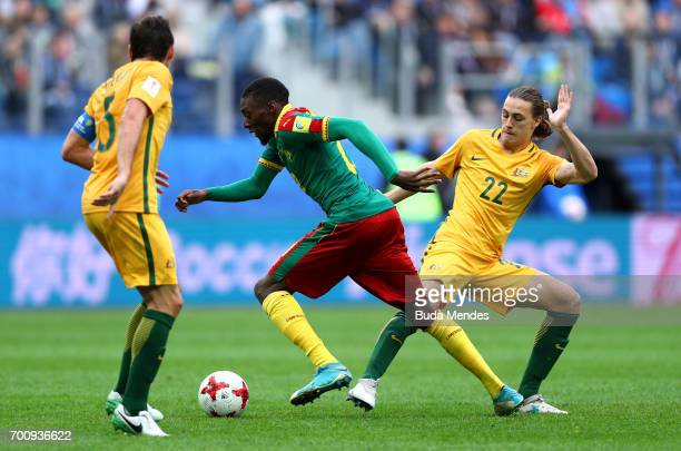 Karl Toko Ekambi of Cameroon goes past Jackson Irvine of Australia and Mark Milligan of Australia during the FIFA Confederations Cup Russia 2017...