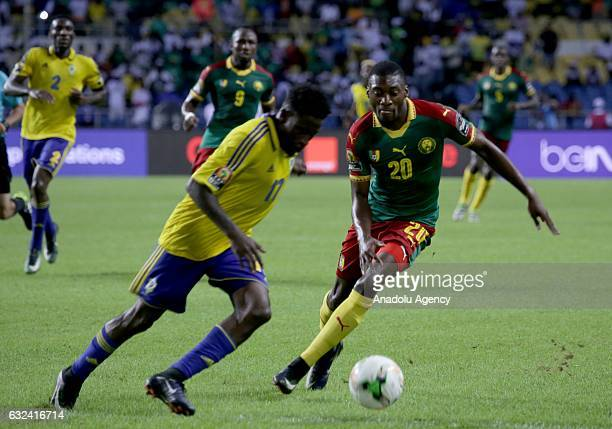 Karl Toko Ekambi of Cameroon in action against Andre Biyogo Poko of Gabon during the 2017 Africa Cup of Nations group A football match between Gabon...
