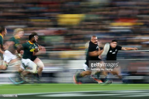 Karl Tu'inukuafe of the All Blacks makes a break during The Rugby Championship match between the New Zealand All Blacks and the South Africa...