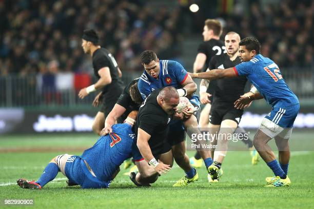 Karl Tu'inukuafe of the New Zealand All Blacks is tackled during the International Test match between the New Zealand All Blacks and France at...