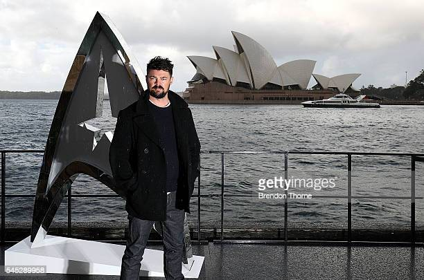Karl Urban poses during a photo call for Star Trek Beyond on July 7 2016 in Sydney Australia