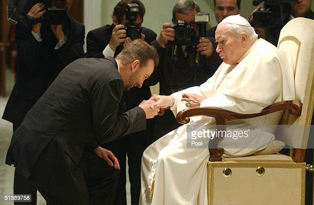 Karl von Habsburg kisses the hand to the Pope John Paul II during a special audience to the participants of Sunday's beatification ceremony on...