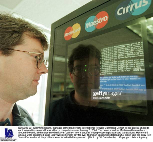 Karl Winkelmann manager of the Mastercard International Network Command Center keeps an eye on credit card transactions around the world on a...