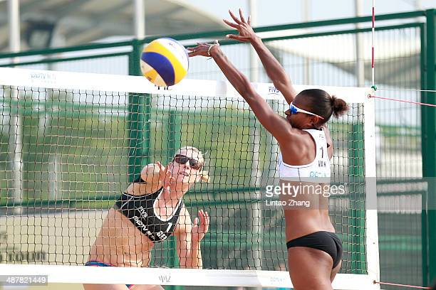karla Borger of Germany in action during the 2014 FIVB Shanghai Jinshan Grand Slam Day three match with Britta Buthe against Miller Elwin and...