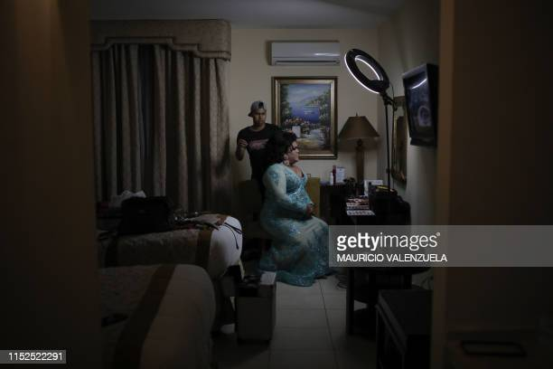 Karla Greta a Panamanian transsexual performer puts on her make up prior to participate in the Panama Gay Awards 2019 in Panama City on June 27 2019...