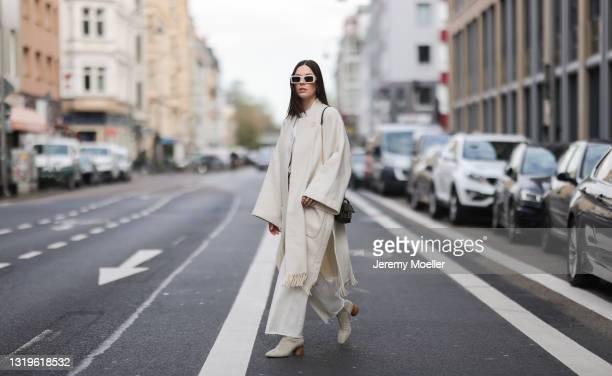 Karla Jenders wearing white Zara jeans, white Zara shirt, beige Zara fringe coat, beige shades, brown Fendi bag and beige Wondergirl ankle boots via...
