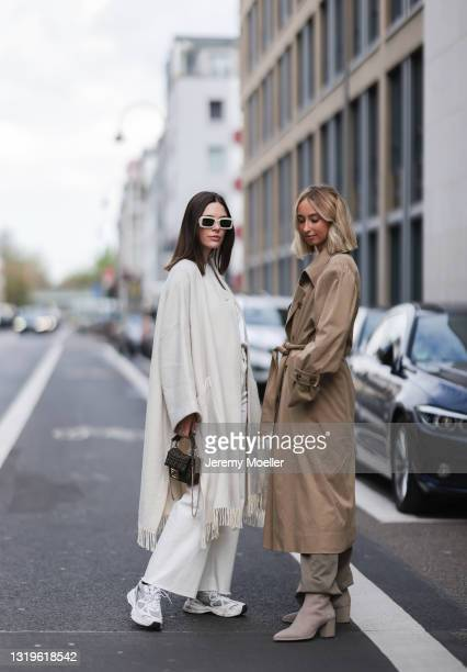 Karla Jenders wearing white Zara jeans, white Zara shirt, beige Zara fringe coat, beige shades, brown Fendi bag and white sneakers via The Wants...