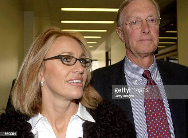 Karla Knafel and her attorney Michael T Hannafan arrive at Cook County Chancery Court to hear arguements March 20 2003 in Chicago Illinois Basketball...
