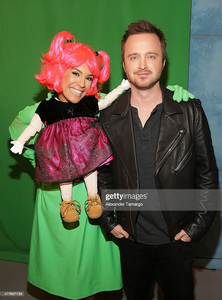 Karla Martinez and Aaron Paul are seen on the set of Univision's Despierta America morning show to promote the movie 'Need for Speed' at Univision Headquarters on March 10, 2014 in Miami, Florida.