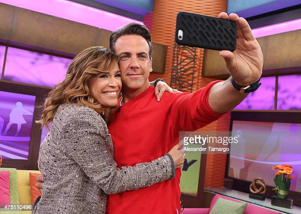 Karla Martinez and Carlos Ponce take a selfie on the set of 'Despierta America' to promote his film 'Spy' at Univision Studios on May 29 2015 in...