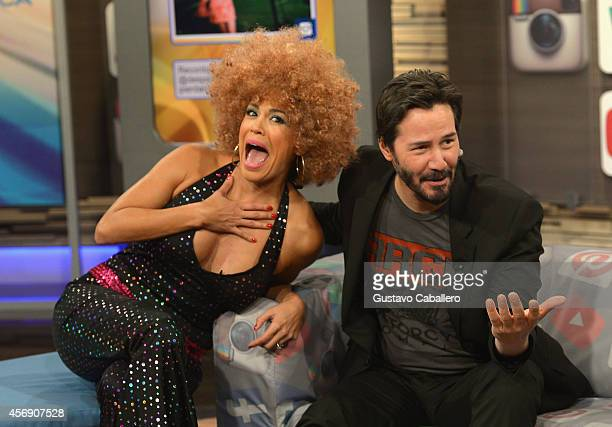 Karla Martinez and Keanu Reeves is on the set of Despierta America at Univision Headquarters on October 9 2014 in Miami Florida