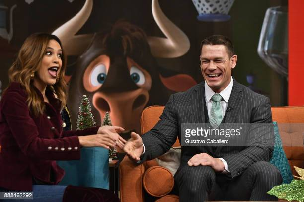 Karla Martinez John Cena are seen on the set of 'Despierta America' to promote the film 'Ferdinand' at Univision Studios on December 8 2017 in Miami...